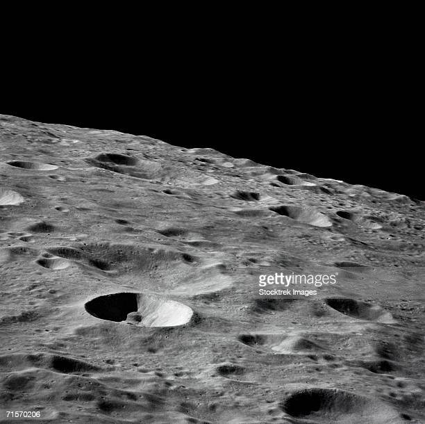"""(16 - 27 april 1972) - this lunar farside oblique view from the apollo 16 spacecraft in lunar-orbit shows the leonov crater, just to the left and above the principal point of the photograph. just beyond the horizon lies the moscow sea."" - meteor crater stock photos and pictures"