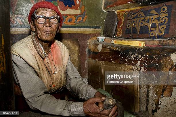 CONTENT] this man a monk himself at kye monastery is turning the big prayer wheel inside the prayer hall as part of making merit