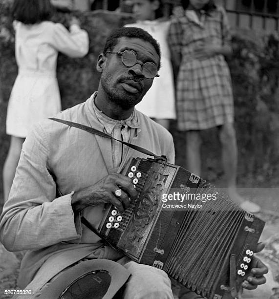 This man makes his living playing a small accordion or 'sanfona' for tips at open air markets
