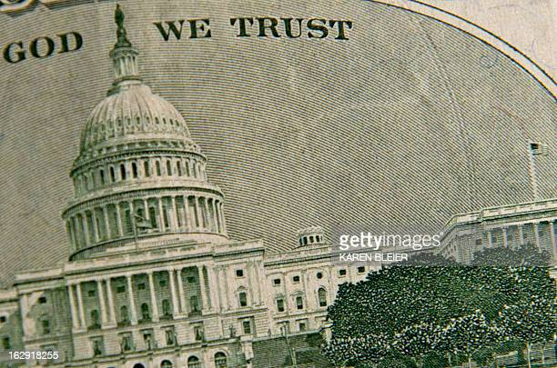 This March 1 2013 photo illustration Taken in Manassas Virginia shows the US Capitol on the back of the twenty USD bill US President Barck Obama met...