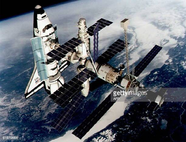 This March 1994 file photo shows a technical rendition of the Space Shuttle Atlantis docked to the Kristall module of the Russian Mir Station. The...