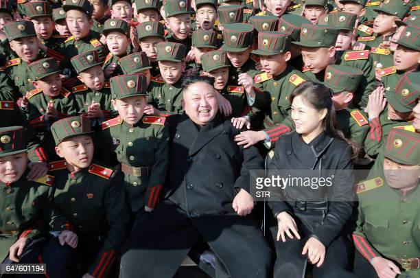 This March 2 2017 picture released by North Korean news agency KCNA on March 3 2017 shows North Korean leader Kim JongUn and his wife Ri SolJu...