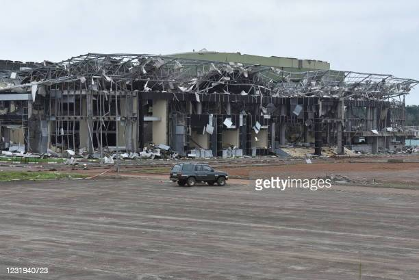 This March 24, 2021 image shows damages to a building located within the military camp in Bata where an explosion took place on March 7 killing 107...