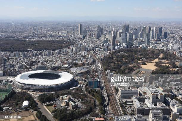 This March 8 2019 aerial picture shows Japan's new national stadium under construction a venue for opening and closing ceremonies football and...