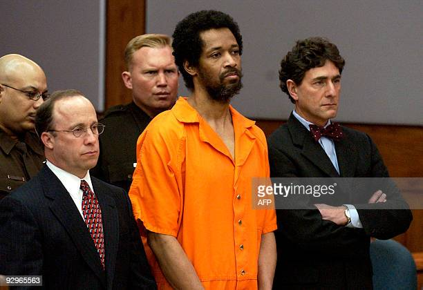 This March 9, 2004 file photo shows convicted sniper John Allen Muhammad standing emotionless with attorney Peter Greenspun and Jonathan Shapiro as...