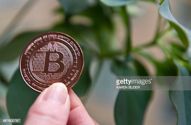 This May 1 2014 photo taken in Washington DC shows a bitcoin medal Bitcoin uses peertopeer technology to operate with no central authority or banks...