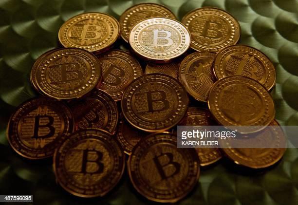 This May 1 2014 photo taken in Washington DC shows bitcoin medals AFP PHOTO / Karen BLEIER / AFP PHOTO