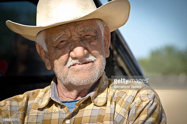 This Mexican Rancher was watching a local Horse Race at Santiago, Baja California Sur, Mexico, leaning against his old truck. Photo taken with...