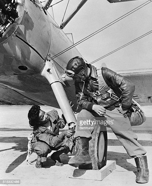 This might be a romance but actually the young Negro girl Marjorie Dorsey apprentice mechanic of Birmingham Alabama is doing a job on the plane that...