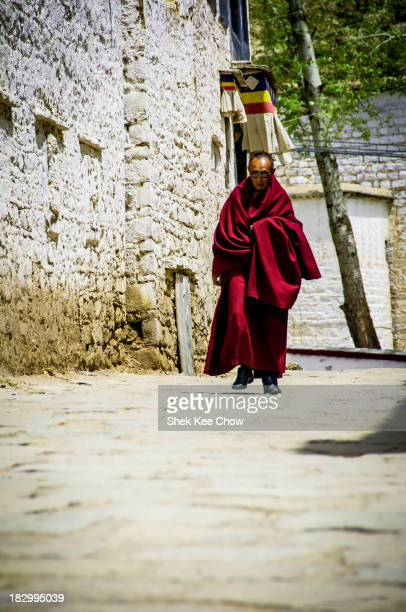 CONTENT] This monk was caught in cool leather shoes and sunglasses under his Lama outfit seemingly walking quickly in a hurry he is heading towards...