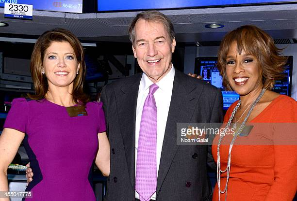 'CBS This Morning' cohosts Norah O'Donnell Charlie Rose and Gayle King ring the closing bell at the New York Stock Exchange on December 10 2013 in...