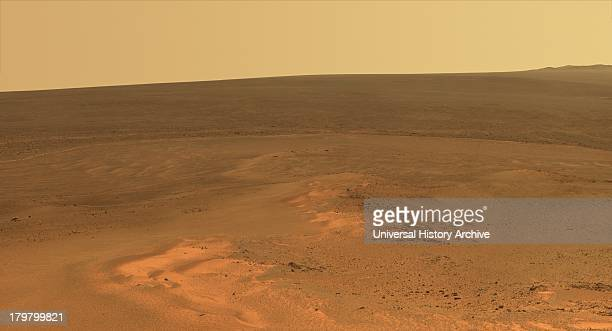 This mosaic of images shows the windswept vista northward to northeastward from the location where NASA's Mars Exploration Rover Opportunity is...