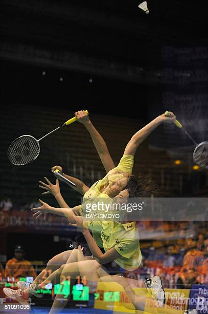 This multiexposed picture shows Lu Lan of China returning a shot to Jang SooYoung of South Korea during their semifinal match at the Uber Cup...