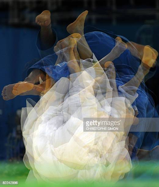 This multiexposure image shows Iran's Arash Miresmaeili and Japan's Masato Uchishiba competing during their men's 66kg match of the 2008 Beijing...