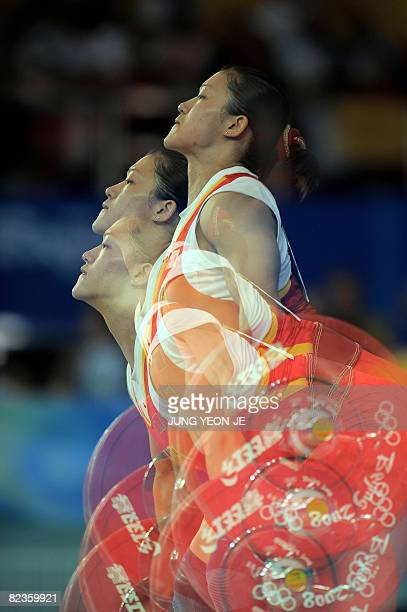 This multiexposure picture shows Cao Lei of China lifting a weight in the women's 75 kg weightlifting event during the 2008 Beijing Olympic Games on...