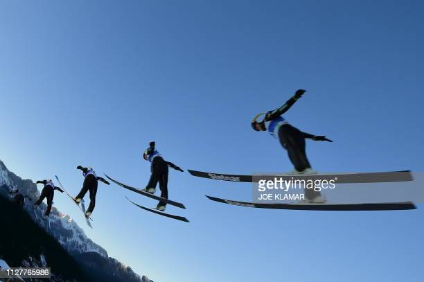 This multiexposure picture shows Japan's Sara Takanashi soaring in the air during the Ladies' ski jumping event at the FIS Nordic World Ski...