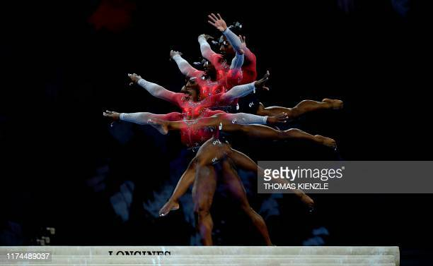 This multiexposure picture shows USA's Simone Biles performing on the beam during the women's team final at the FIG Artistic Gymnastics World...