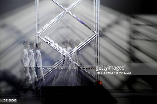 This multiexposure pictures shows models displaying outfits by Spanish designer David Delfin during the presentation of the Autumn/Winter collections...