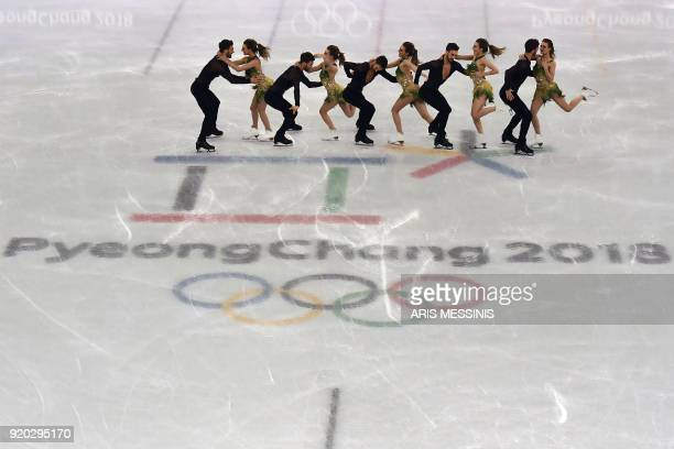TOPSHOT This multiple exposure image shows France's Gabriella Papadakis and France's Guillaume Cizeron competing in the ice dance short dance of the...