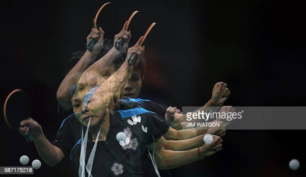 This multiple exposure image shows Taiwan's Cheng IChing hitting a shot in her women's singles qualification round table tennis match at the...