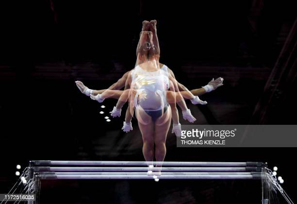 This multiple exposure photo shows Germany's Kim Bui performing on the uneven bars during a training session at the FIG Artistic Gymnastics World...
