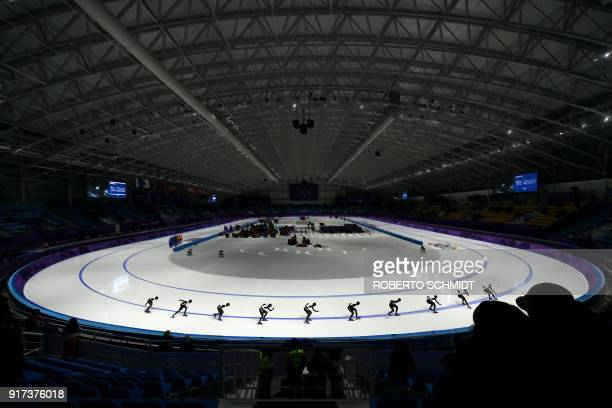TOPSHOT This multiple exposure photo shows Japan's Miho Takagi warming up for the women's 1500m speed skating event during the Pyeongchang 2018...