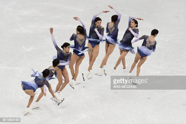 TOPSHOT This multiple exposure photo shows Russia's Evgenia Medvedeva competing in the women's single skating short program of the figure skating...