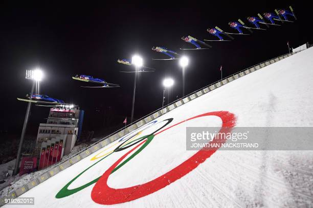 TOPSHOT This multiple exposure picture shows Germany's Richard Freitag competing in the men's large hill individual ski jumping event trial for...