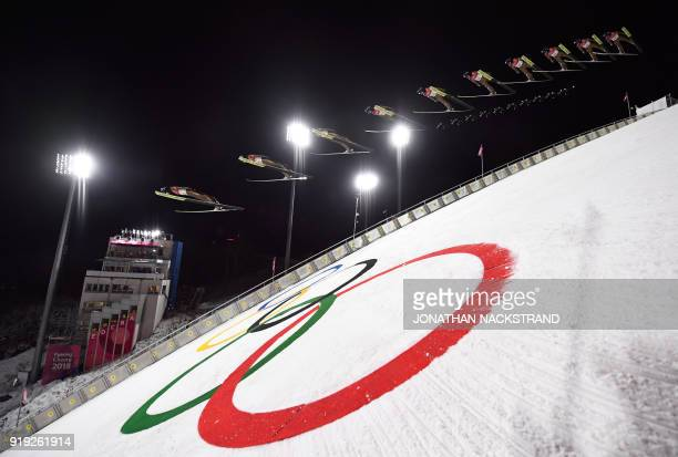 TOPSHOT This multiple exposure picture shows Poland's Kamil Stoch competing in the men's large hill individual ski jumping event trial for...