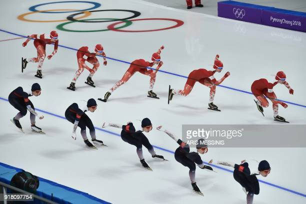This multiple exposure shows Poland's Karolina Bosiek and Czech Republic's Nikola Zdrahalova competing in the women's 1000m speed skating event...