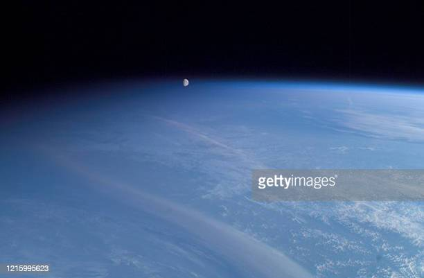 This NASA handout image obtained 10 June 2003 captured by the astronauts onboard the International Space Station shows what appears to be the moon...