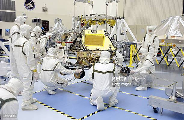 This NASA handout image shows technicians working with a Mars Exploration Rover in the Payload Hazardous Servicing Facility March 20 2003 at Kennedy...