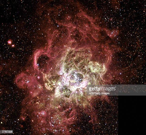 This NASA Hubble Space Telescope image released 04 December, 2003 shows a festively colored nebula, called NGC 604, one of the largest known seething...
