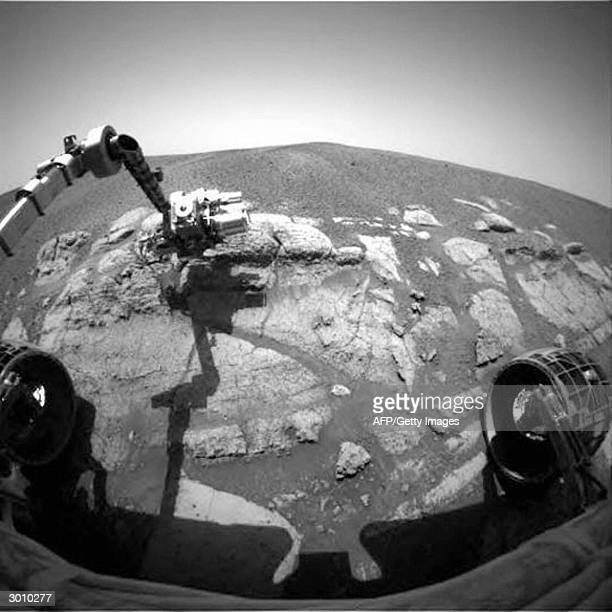 This NASA image released 24 February 2004 shows NASA's Mars Exploration Rover Opportunity casting a shadow over the El Capitan area that the rover is...