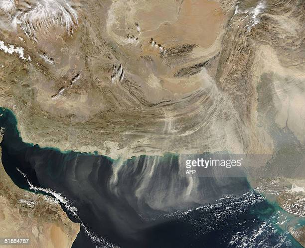 This NASA satellite image released 21 December 2004 shows bands of dust blowing south over the Arabian Sea during a dust storm 19 December 2004 The...