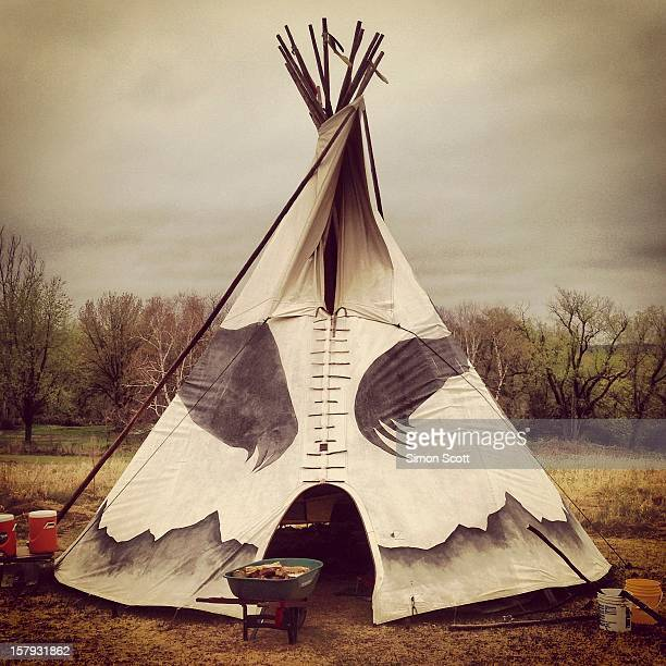 This Native American teepee is traditionally used for medicine ceremonies and for shelter. With a fireplace in the center, the smoke can exit rough a...