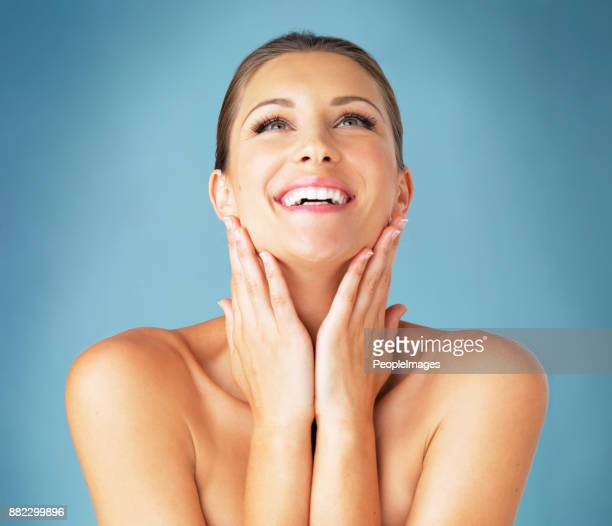 this neck cream is working wonders! - neck stock photos and pictures