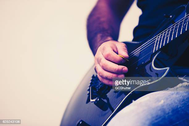 this new pick is too stiff for me. - blues music stock pictures, royalty-free photos & images