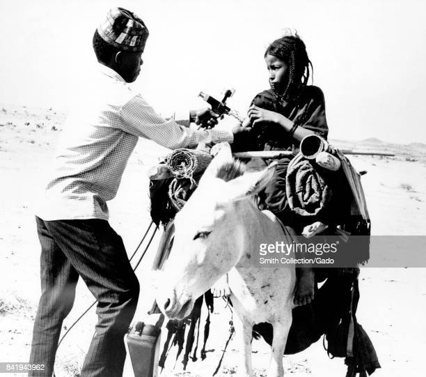 This nomadic Tuareg girl is receiving a smallpox vaccination in Mali West Africa 1967 Image courtesy CDC