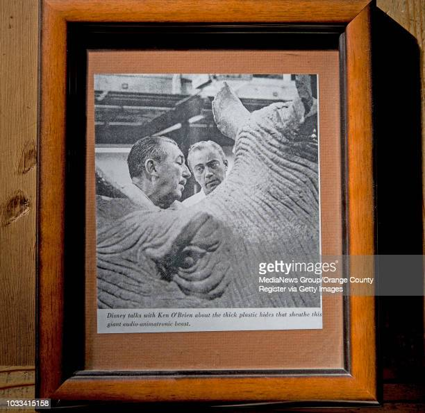 This O'Brien family photo shows Walt Disney left with Ken O'Brien The caption reads 'Disney talks with Ken O'Brien about the thick plastic hides that...