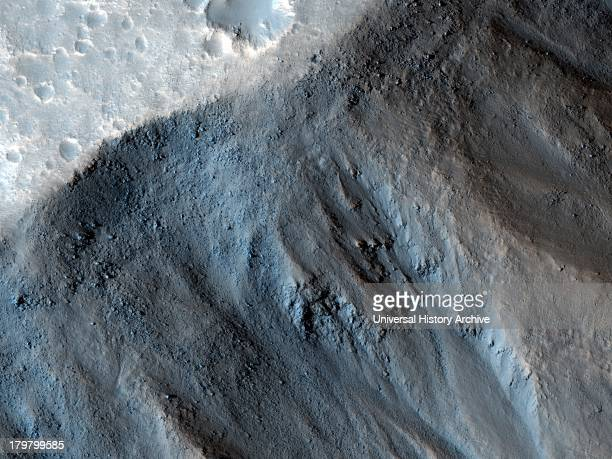 This observation from NASA's Mars Reconnaissance Orbiter shows the very steep side of a plateau part of the northern limit of the Kasei Valles system...