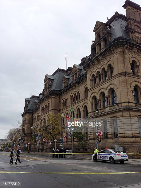 This October 16 2013 photo shows the office of the prime minister of Canada in Ottawa Canada from behind a police barrier after it was locked down...