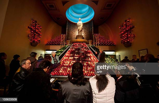 This October 17 2010 photo shows worshippers on their knees praying to St Joseph near Saint Brother Andre's tomb at Saint Joseph's Oratory basilica...