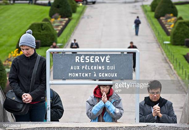 This October 17 2010 photo shows worshippers praying on the steps of Saint Joseph's Oratory basilica on the slopes of Montreal's Mount Royal in...