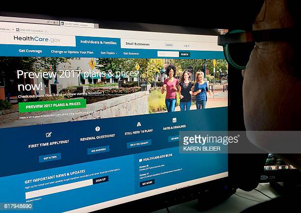 This October 25 2016 photo shows a woman looking at the Healthcaregov internet site in Washington DC Americans will see Obamacare health insurance...