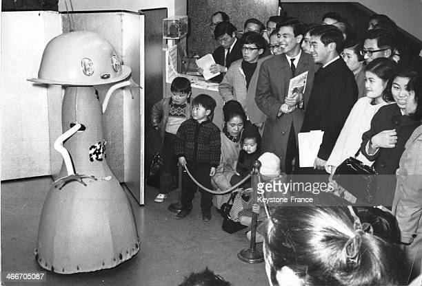 This odd shaped robot which can dance the twist sing and talk is attracting crowds of Christmas shoppers to a Tokyo department store on December 13...