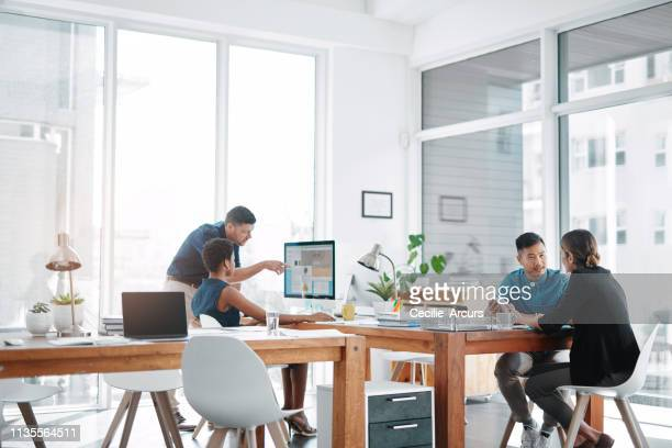 this office runs on teamwork - office stock pictures, royalty-free photos & images