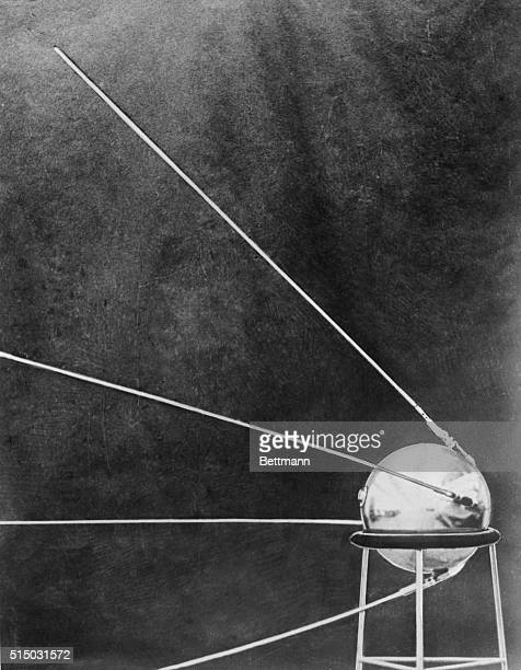 This official photo released by Moscow shows the Soviet satellite Sputnik I It shows the artificial moon resting on a metal stand before it was put...