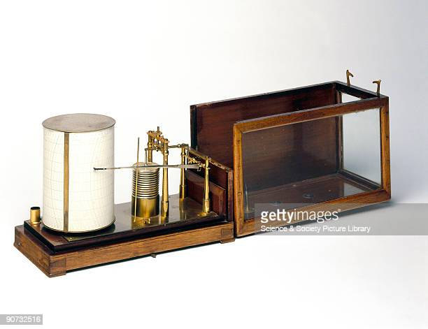 This open scale barograph in a glazed carrying case was made by Short and Mason Changes in atmospheric pressure cause the series of aneroid capsules...