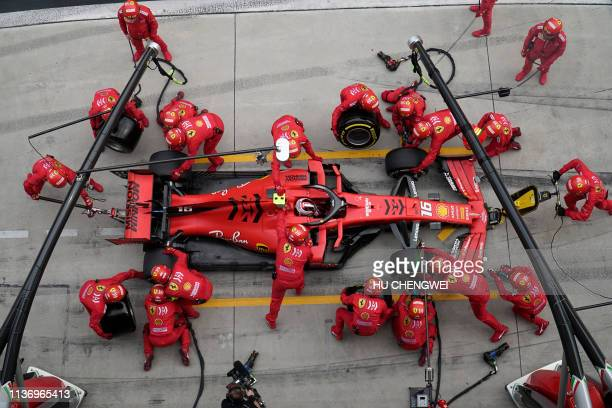 This overhead view shows Ferrari's Monegasque driver Charles Leclerc making a pit stop during the Formula One Chinese Grand Prix in Shanghai on April...